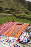 Peruvian traditional wares near ruins in Cusco in Peru. Peruvian traditional wares for sale near ruins in Cusco in Peru Royalty Free Stock Photography