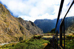 Peruvian train and ancient buildings Stock Photo