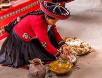 Peruvian uses natural dyes to color fiber royalty free stock photos