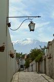 Peruvian village with snow-capped mountain backdrop Stock Photos