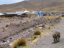 Peruvian village in wilderness. Scenic view of small remote village with railway line and mountains in background, Peru Stock Images