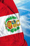 Peruvian waving flag on a beautiful day Stock Image