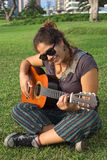 Peruvian Woman Playing the Guitar Royalty Free Stock Image