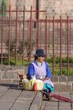 Peruvian woman selling breakfast food in the street of Cusco, Pe Royalty Free Stock Photo