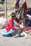 Peruvian woman selling handcrafts Stock Photography