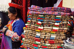 Peruvian woman selling handmade blankets Royalty Free Stock Photo