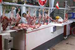 Peruvian woman sells fresh meat Stock Photo