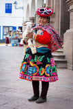 Peruvian woman in traditional dresses Stock Images