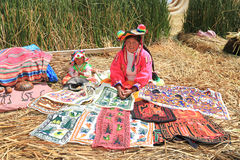 Peruvian Woman at Uros Island in traditional colorful cloth Royalty Free Stock Photo