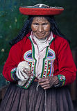 Peruvian woman weaving Stock Photo