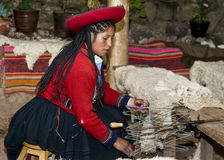 Peruvian woman weaving Stock Images