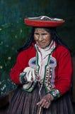 Peruvian woman weaving Stock Images