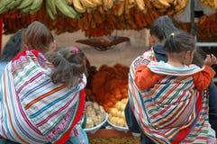 Peruvian women at market. Image taken of two peruvian women in traditional dress, shopping in magdelena, lima, peru royalty free stock image