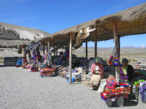 Peruvian women selling handcrafts. On road side to Colca Canyon. Colca Canyon is a canyon of the Colca River in southern Peru, located about 100 miles (160 Royalty Free Stock Photo