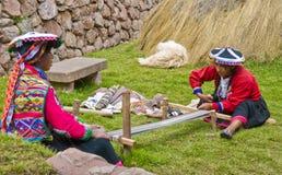 Peruvian women weaving. Cusco , Peru - May 26 2011 : Quechua Indian women weaving with strap loom Royalty Free Stock Photography
