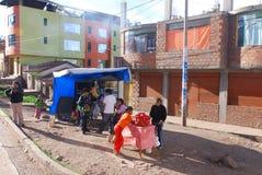Peruvians prepare food Stock Images