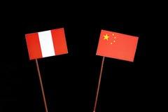 Peruwiańska flaga z chińczyk flaga na czerni obraz royalty free
