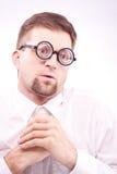 Pervert nerd looking at imaginary boobs. Portrait of a funny pervert nerd looking at imaginary boobs stock photo