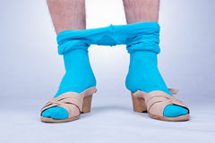 Perverted. Front view of man's legs standing in female shoes and tights Royalty Free Stock Photos