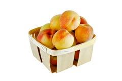 Perziken in een mand Stock Foto