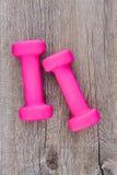 Pesa de gimnasia rosada del gimnasio Imágenes de archivo libres de regalías