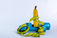 Pesa de gimnasia y plátano Foto de archivo
