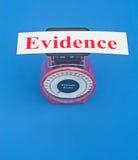 Pesage des preuves Photographie stock