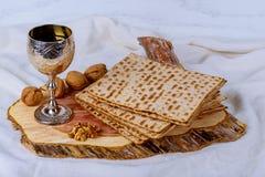 A Jewish Matzah bread with wine. Passover holiday concept. Pesah celebration concept Jewish Matzah bread with wine. Passover holiday concept Royalty Free Stock Photo
