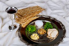Pesah celebration concept jewish Passover holiday. Egg and seder plate stock photography