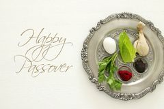Pesah celebration concept & x28;jewish Passover holiday& x29;. Traditional pesah plate with five symbols: horseradish, celery, egg, bone, maror, charoset Royalty Free Stock Photo