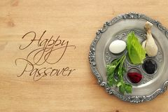 Pesah celebration concept & x28;jewish Passover holiday& x29;. Traditional pesah plate with five symbols: horseradish, celery, egg, bone, maror, charoset Stock Photos