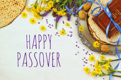 Pesah celebration concept & x28;jewish Passover holiday& x29;. Traditional book with text in hebrew: Passover Haggadah & x28;Passover Tale& x29 Stock Photos