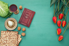 Pesah celebration concept & x28;jewish Passover holiday& x29;. Pesah celebration concept & x28;jewish Passover holiday& x29;. Traditional book with text Stock Image