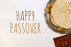 Pesah celebration concept & x28;jewish Passover holiday& x29;. Traditional book with text in hebrew: Passover Haggadah & x28;Passover Tale& x29 Stock Photo