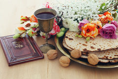 Pesah celebration concept & x28;jewish Passover holiday& x29;. Pesah celebration concept & x28;jewish Passover holiday& x29;. Traditional book with text Stock Photo