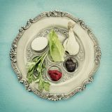 Pesah celebration concept & x28;jewish Passover holiday& x29;. Traditional pesah plate with five symbols: horseradish, celery, egg, bone, maror, charoset Stock Images