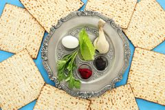 Pesah celebration concept & x28;jewish Passover holiday& x29;. Traditional pesah plate with five symbols: horseradish, celery, egg, bone, maror, charoset Royalty Free Stock Image