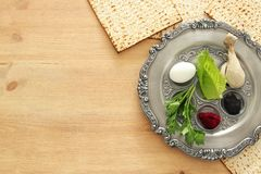Pesah celebration concept & x28;jewish Passover holiday& x29;. Traditional pesah plate with five symbols: horseradish, celery, egg, bone, maror, charoset Stock Photography