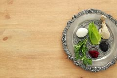 Pesah celebration concept & x28;jewish Passover holiday& x29;. Traditional pesah plate with five symbols: horseradish, celery, egg, bone, maror, charoset Stock Photo