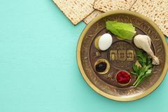 Pesah celebration concept & x28;jewish Passover holiday& x29;. Traditional pesah plate with five symbols: horseradish, celery, egg, bone, maror, charoset. Text Stock Images