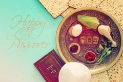 Pesah celebration concept & x28;jewish Passover holiday& x29;. Traditional pesah plate with five symbols: horseradish, celery, egg, bone, maror, charoset. Text Royalty Free Stock Photo