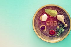 Pesah celebration concept & x28;jewish Passover holiday& x29;. Traditional pesah plate with five symbols: horseradish, celery, egg, bone, maror, charoset. Text Stock Photos