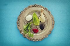 Pesah celebration concept & x28;jewish Passover holiday& x29;. Traditional pesah plate with five symbols. Horseradish, celery, egg, bone, maror, charoset Royalty Free Stock Photos