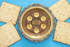 Pesah celebration concept & x28;jewish Passover holiday& x29;. Traditional pesah plate text in hebrew: Passover, horseradish, celery, egg, bone, maror Royalty Free Stock Images