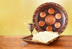 Pesah celebration concept (jewish Passover holiday) with wine and matza.  Stock Photography