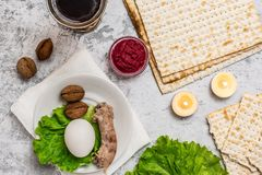 Pesah celebration concept. Passover background with wine, matza and seder plate on grey. Top view. With copy space stock photo