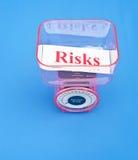 Pesaje de los riesgos Fotografía de archivo