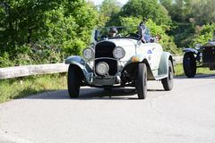 CHRYSLER 75 1929 racing car in rally Mille Miglia 2018 the famous italian historical race 1927-1957. PESARO COLLE SAN BARTOLO , ITALY - MAY 17 - 2018 : on an old royalty free stock photos