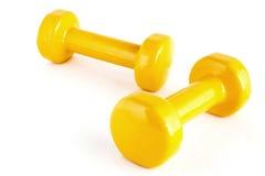 Pesas de gimnasia amarillas Fotografía de archivo