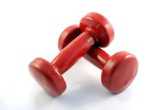 Pesas de gimnasia rojas de Metall fotos de archivo libres de regalías
